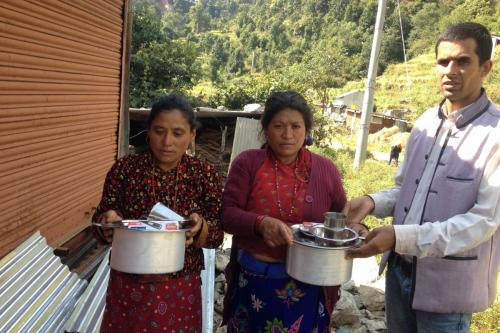 Mother of Dawa Dolma and Sonam Tamang (Golphu) are receiving utencils and torch light